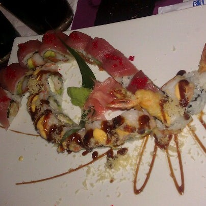 Photo taken at Sushi Cafe by Jaimie H. on 12/8/2012