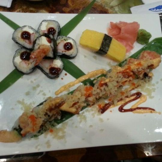 Photo taken at Sushi Cafe by Jaimie H. on 12/23/2012