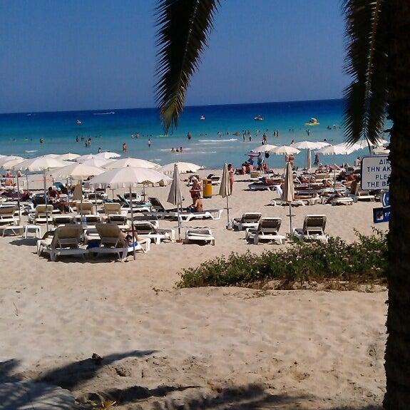 Photo taken at Makronissos Beach by Daria S. on 7/2/2013