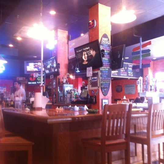 Photo taken at Boardwalk Billy's Raw Bar & Ribs by Mark B. on 12/9/2012