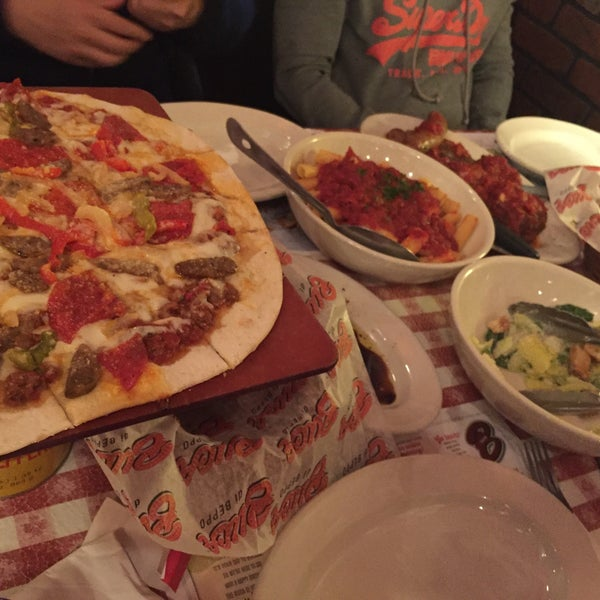 Photo taken at Buca di Beppo by Jonathan Y. on 3/6/2017