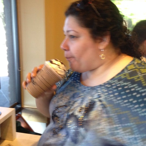 Photo taken at Starbucks by Nelly C. on 5/4/2014