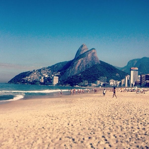 Photo taken at Ipanema Beach by Daniel V. on 7/14/2013