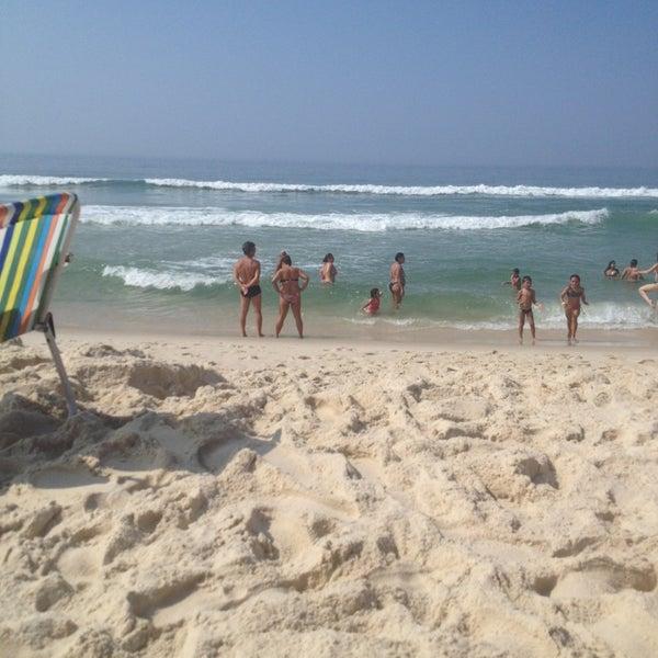 Photo taken at Praia da Barra da Tijuca by Amanda G. on 12/27/2012