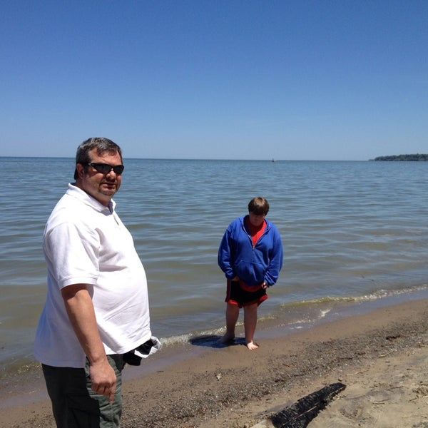 Photo taken at Durand Eastman Beach by Marie E. on 5/31/2014