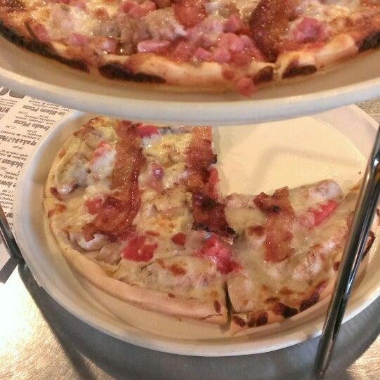Photo taken at Black Market Pizza by Manny O. on 8/15/2014