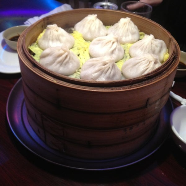 Photo taken at Shanghai Café Deluxe by Nick O. on 12/29/2012