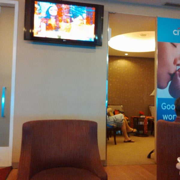 Photo taken at Citibank Lounge by Melly D. on 12/25/2013