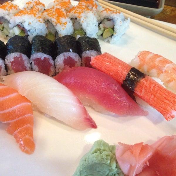 Photo taken at Sushi Cafe by Nikko M. on 8/8/2014