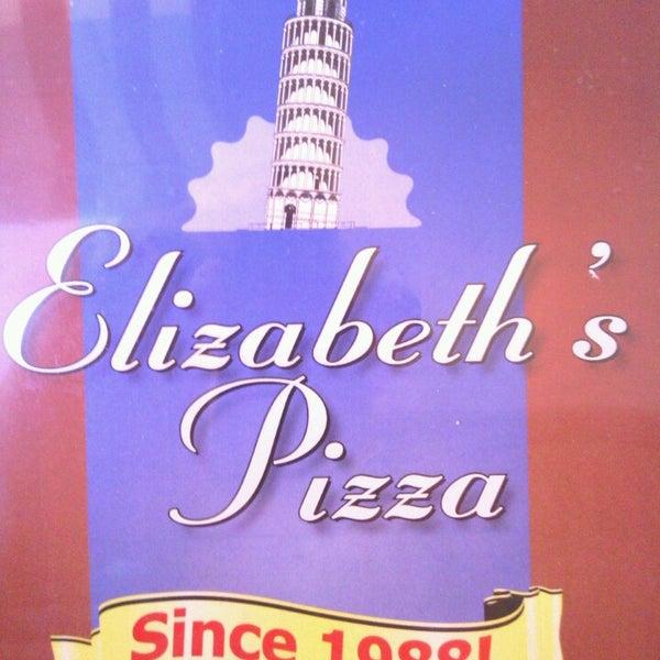Photo taken at Elizabeth's Pizza by Tom B. on 9/26/2013