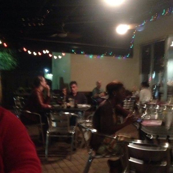 Photo taken at Sushi Cafe by Jeffery S. on 12/7/2013