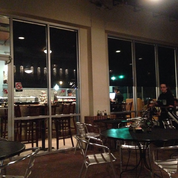 Photo taken at Sushi Cafe by Jeffery S. on 4/4/2014