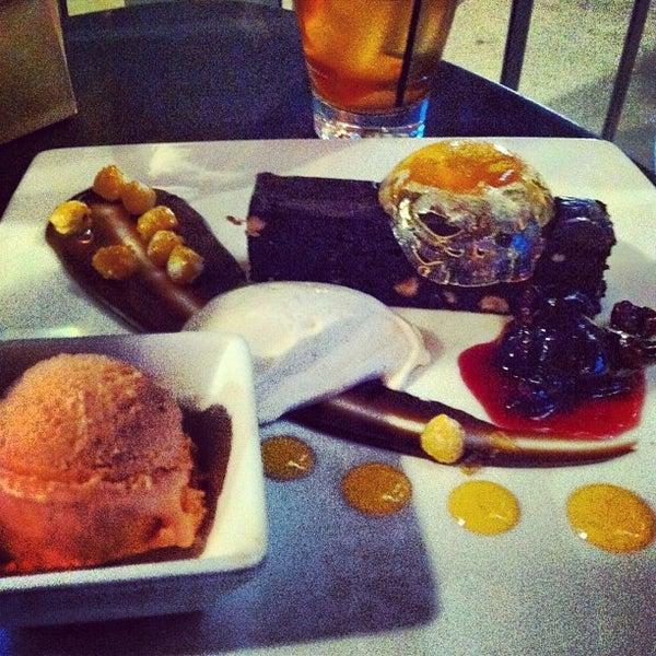 Photo taken at Crave Dessert Bar & Lounge by Bridget F. on 7/20/2013