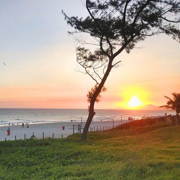 Photo taken at Praia da Barra da Tijuca by Gabriela P. on 2/20/2013