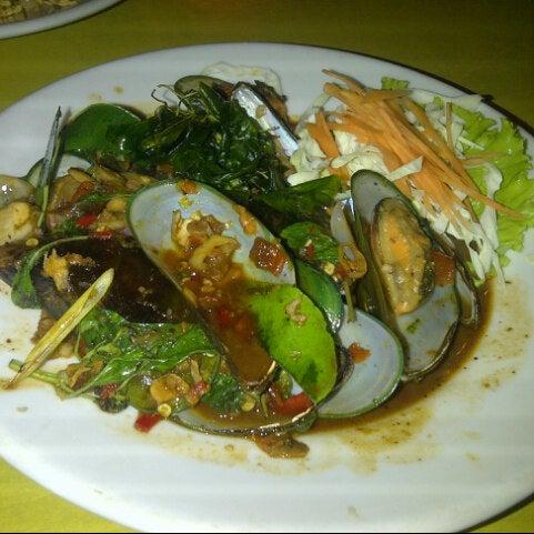 Photo taken at Phuket Thai Resto by Winda A. on 2/16/2013