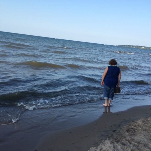 Photo taken at Durand Eastman Beach by Jeremy M. on 8/10/2014