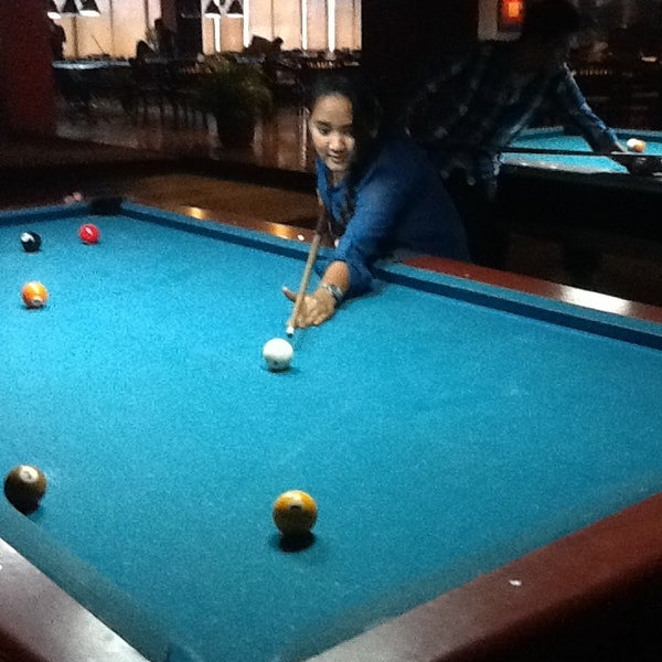 Photo taken at Rick's Cafe & Billiard by Vhebry Ranie B. on 3/27/2013