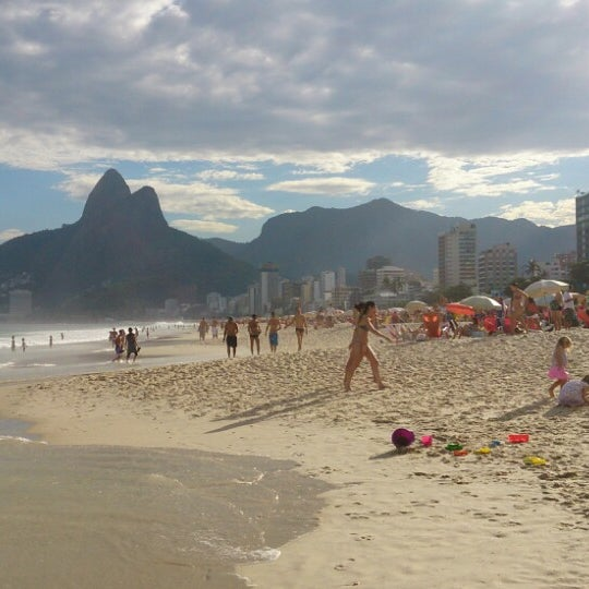 Photo taken at Ipanema Beach by Bruno M. on 6/29/2013