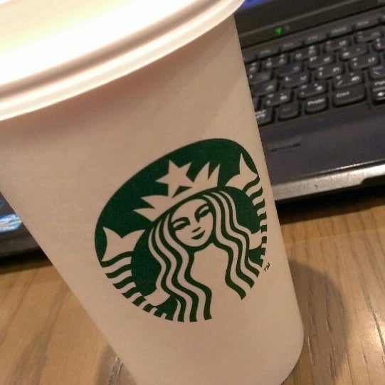 Photo taken at Starbucks by Hiro I. on 3/12/2014