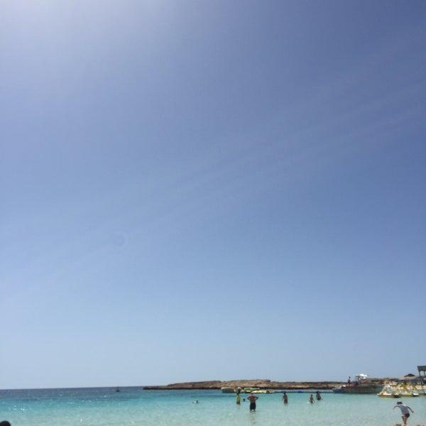 Photo taken at Makronissos Beach by Anastasiia P. on 5/17/2017