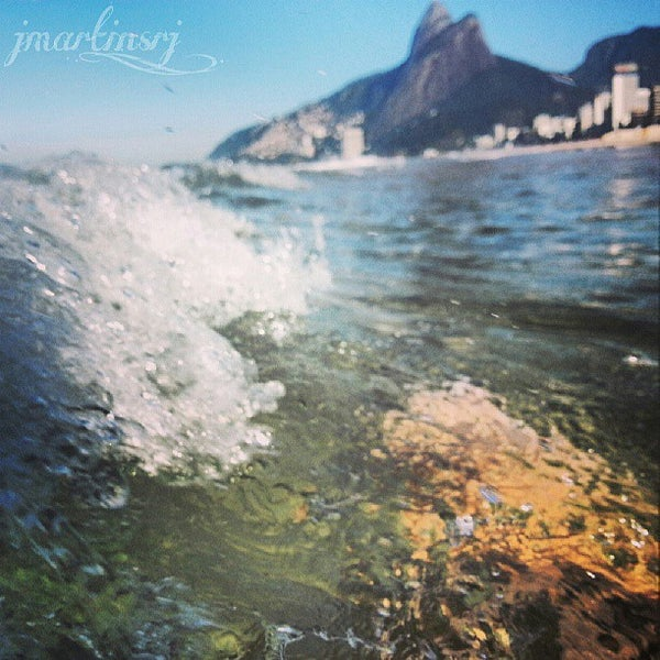Photo taken at Ipanema Beach by Jessica M. on 7/6/2013