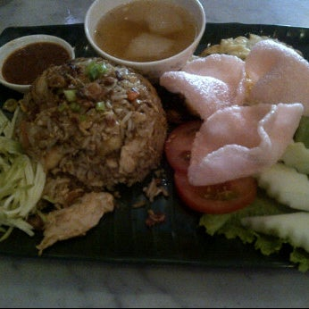 Photo taken at The Wok Cafe by Alvin L. on 3/15/2012
