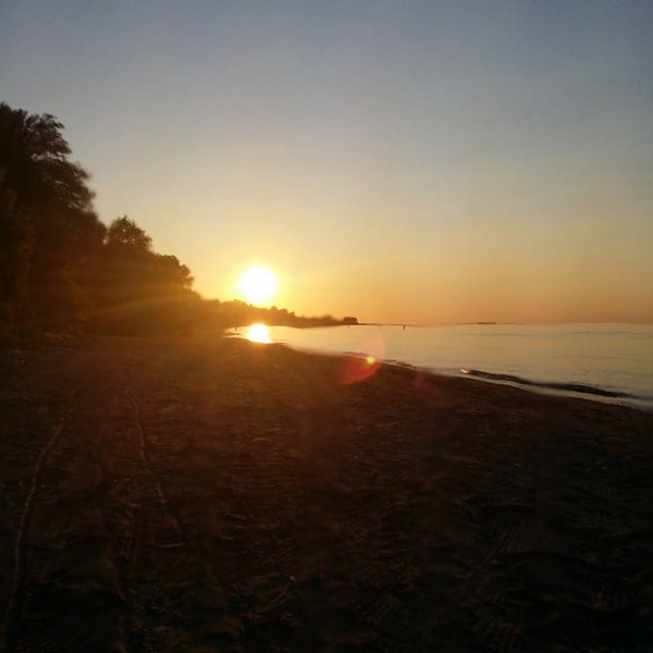 Photo taken at Durand Eastman Beach by Eric D. on 7/3/2015