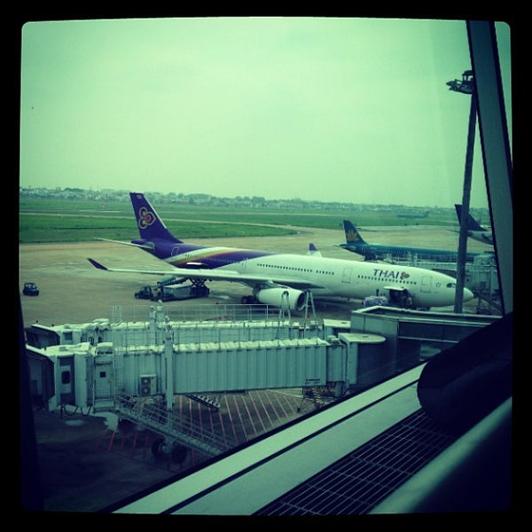 Photo taken at Tan Son Nhat International Airport (SGN) by KuTy on 5/30/2013
