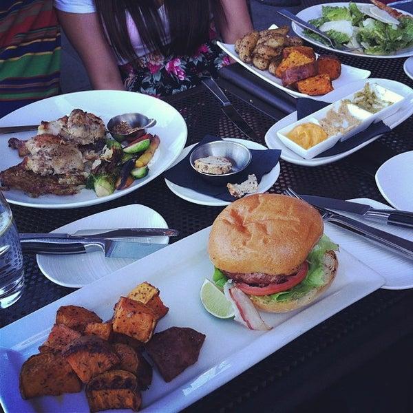 Photo taken at Glow Restaurant by Raein D. on 6/14/2013