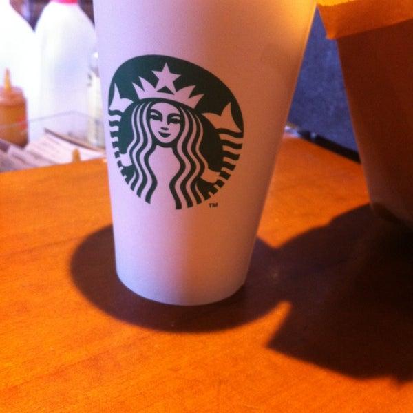 Photo taken at Starbucks by Darren W. on 4/11/2013