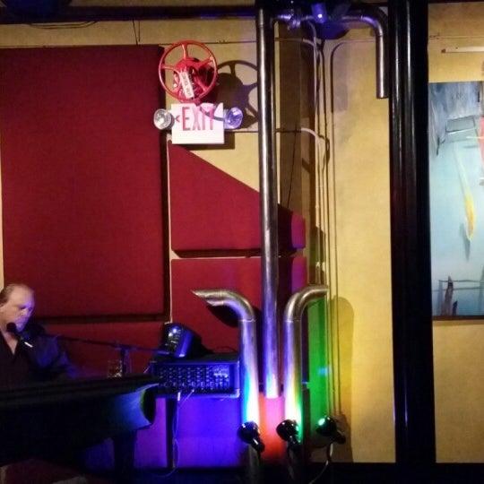 Photo taken at Jazz'd Tapas Bar by Kana L. on 12/19/2013