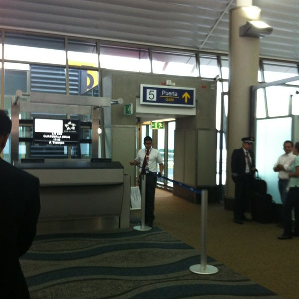 Photo taken at Gate 5 Aeropuerto Internacional Juan Santamaria by José C. on 2/15/2013