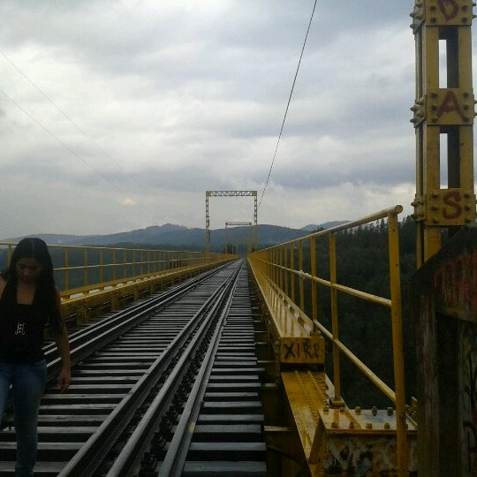 Photo taken at Monumento Nacional Puente Malleco by Ibexita M. on 2/9/2013