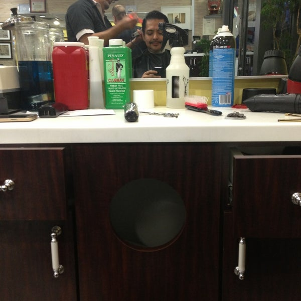 Photo taken at Manhattan Barber Shop by William O. on 11/25/2014