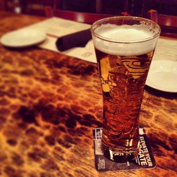 Photo taken at Fado Irish Pub & Restaurant by Marcus D. on 3/19/2013