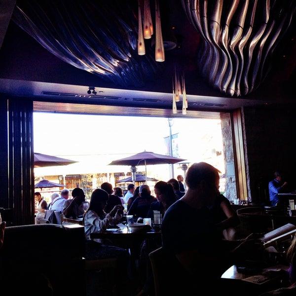 Photo taken at Glow Restaurant by Natasha V. on 5/4/2013