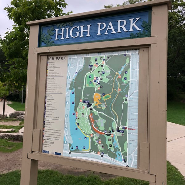 huge park with gardens, playgrounds, dog runs, ponds, sporting areas, and more as well as wilderness spaces and trails in a residential area of western toronto.