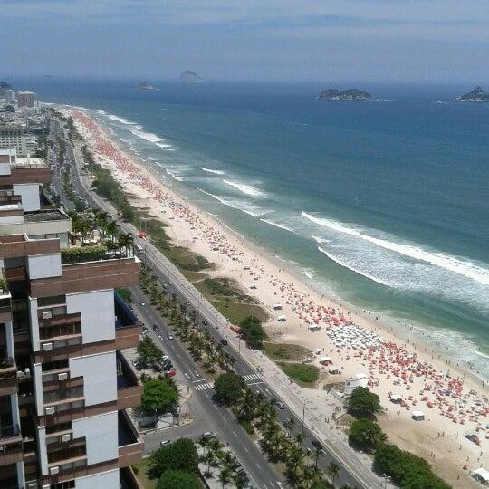 Photo taken at Praia da Barra da Tijuca by Marina K. on 2/3/2013