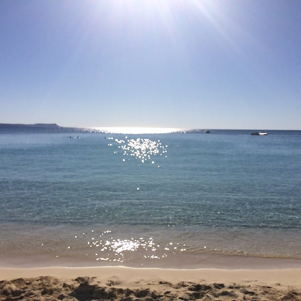 Photo taken at Makronissos beach by Lia on 9/26/2016