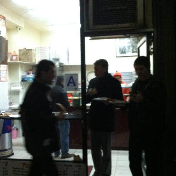 Photo taken at 99¢ Fresh Pizza by Alan M. on 2/19/2013