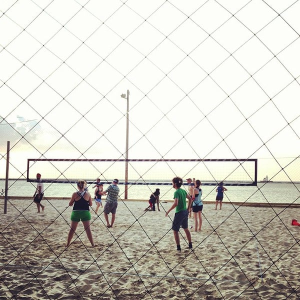 Photo taken at Whiskey Island Volleyball Courts by Luis C. on 6/24/2013