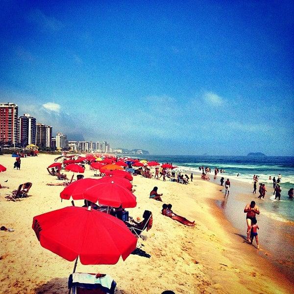 Photo taken at Praia da Barra da Tijuca by Patrick v. on 12/27/2012