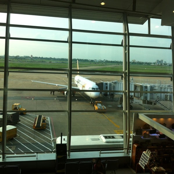 Photo taken at Tan Son Nhat International Airport (SGN) by Nat R. on 5/26/2013