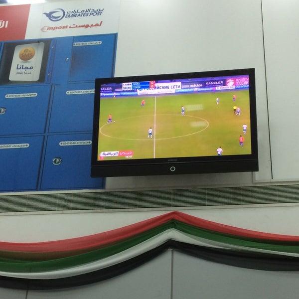 Photo taken at Emirates Post Office مكتب بريد الإمارات by Marina O. on 3/31/2014
