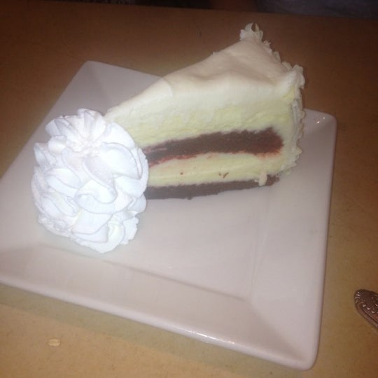 Photo taken at The Cheesecake Factory by Lucy P. on 7/22/2012