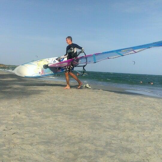 Photo taken at Playa El Yaque by Elena O. on 5/21/2013