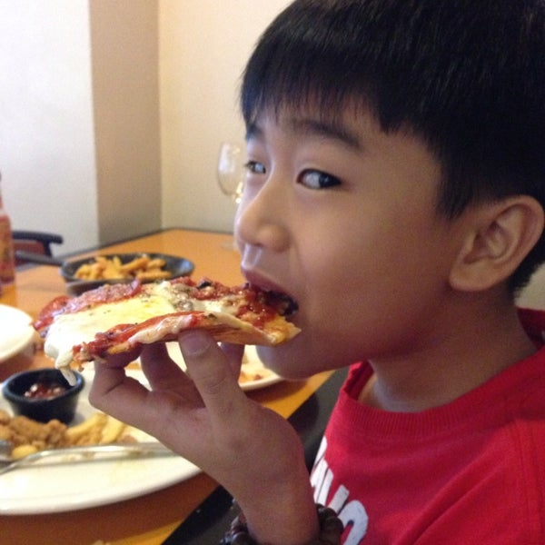Photo taken at California Pizza Kitchen by Karen T. on 6/28/2014