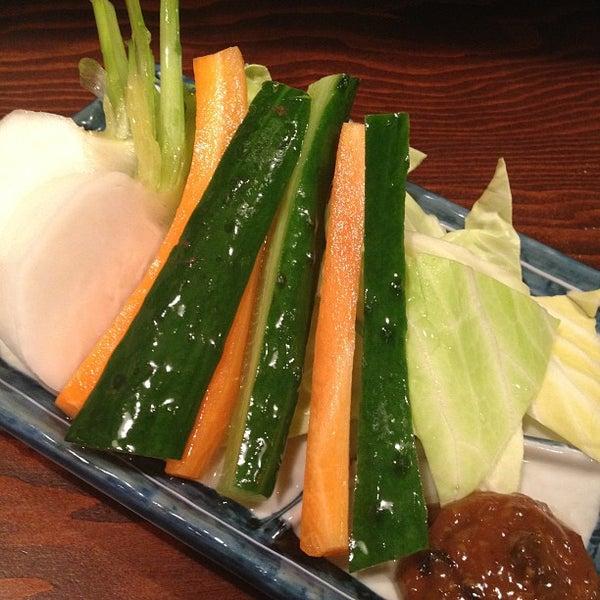 Photo taken at 日本橋 紅とん 池袋ビックリガード店 by K T. on 3/8/2013