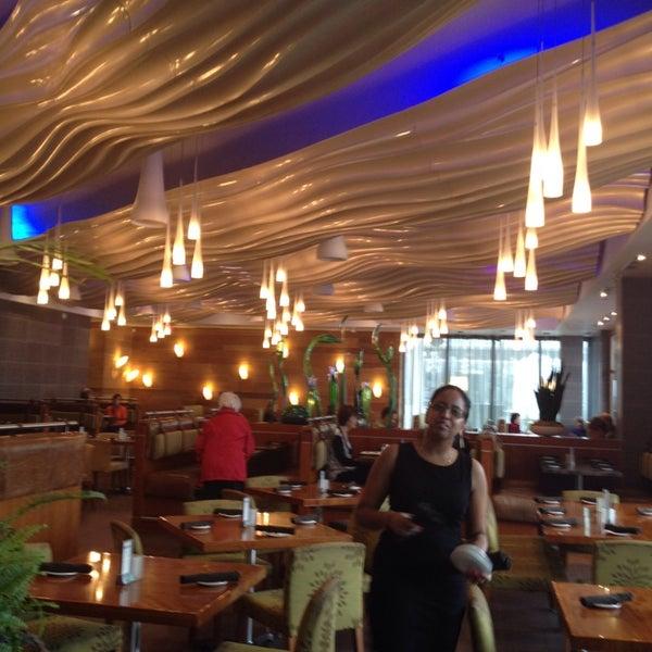 Photo taken at Glow Restaurant by Georgina B. on 11/1/2013
