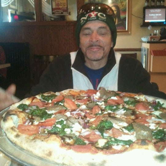 Photo taken at Fire Works Pizza by Travis W. on 2/3/2012